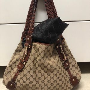 """Authentic Gucci hobo bag with classic """"GG"""" print."""